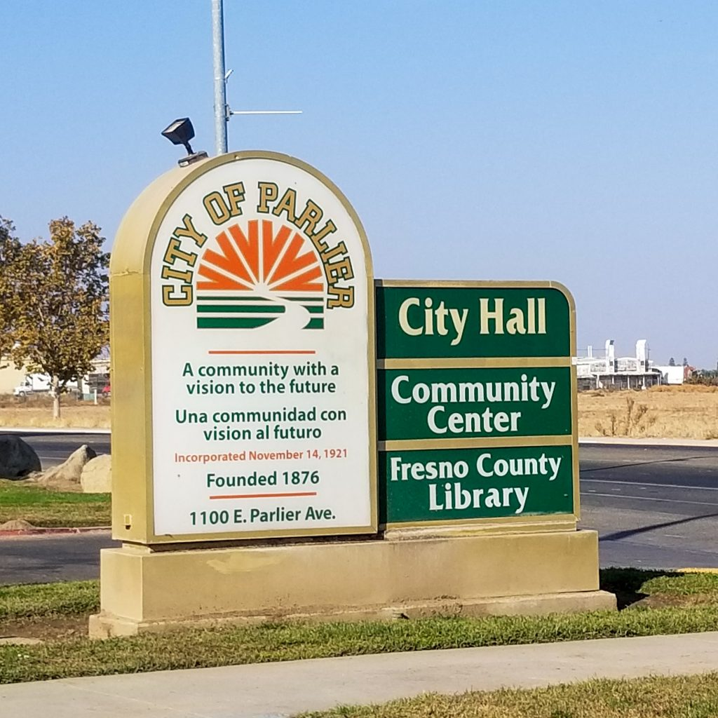 City of Parlier City Hall, Community Center and Fresno County Library sign.