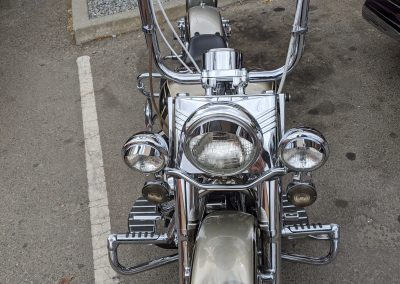 Front of a motorcycle parked on the street.