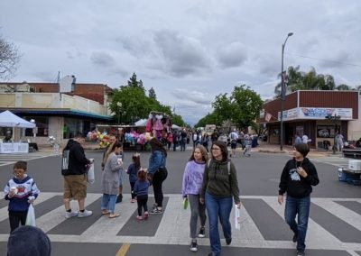 People walking around at a street festival.